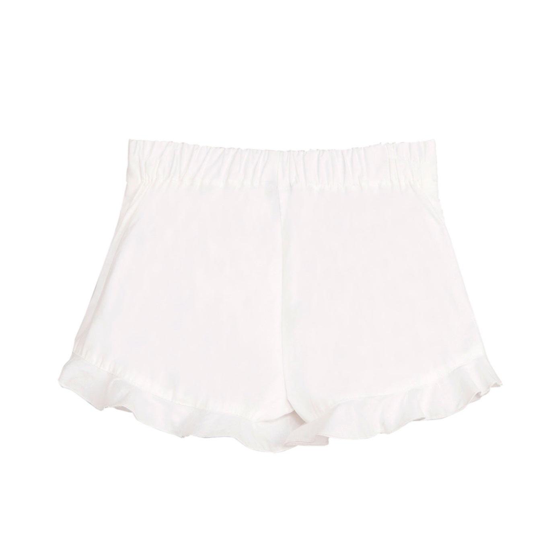 Imagen de Falda pantalón de niña en blanco con volante