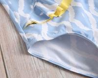 Picture of Bañador niña asimétrico azul con estampado de rombos blancos