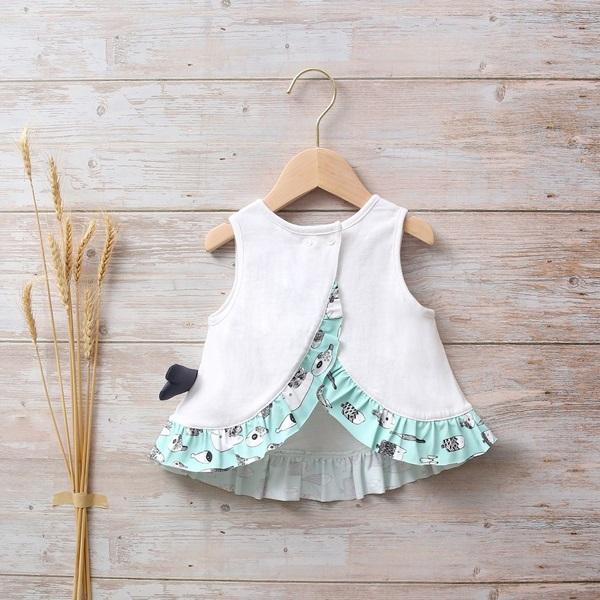 Picture of Camiseta bebé niña blanca sin mangas con volante de estampado