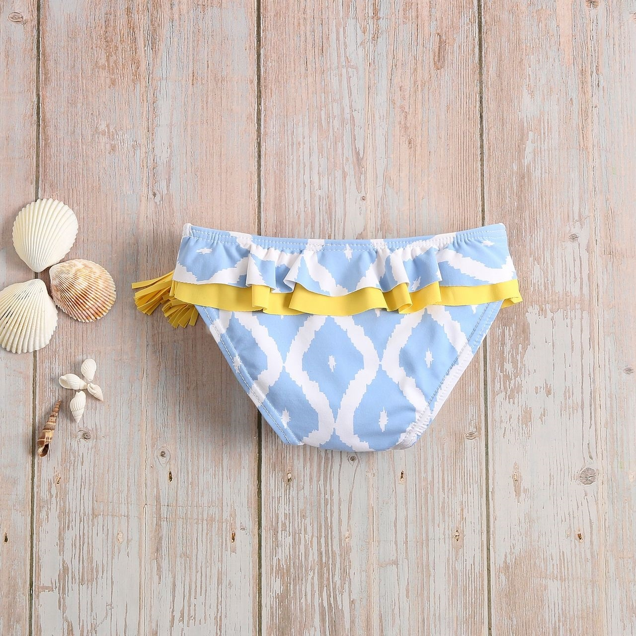 Imagen de Culetín bebé niña azul con estampado de rombos blancos
