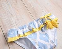 Image de Culetín bebé niña azul con estampado de rombos blancos