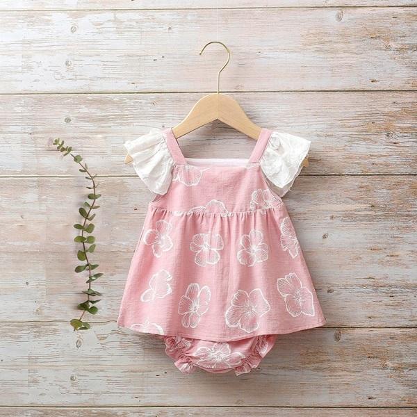 Imagen de Vestido bebé Dalía rosa de flores tipo peto