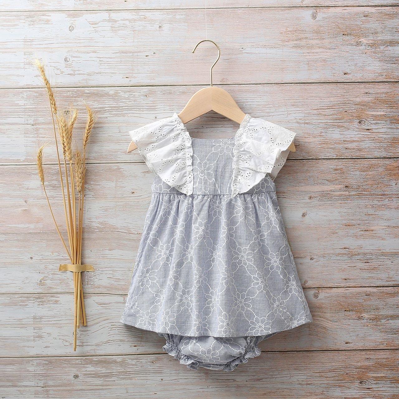 Image sur Vestido bebé rayas azul con estampado de margaritas y volantes