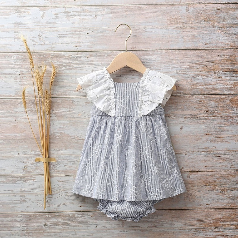 Image de Vestido bebé rayas azul con estampado de margaritas y volantes