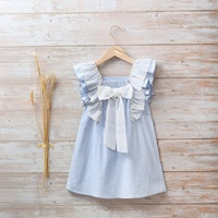 Imagen de Vestido niña con doble volante y lazo de plumeti