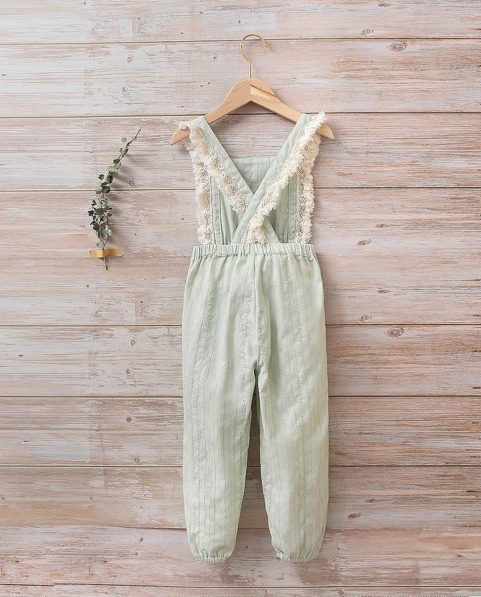 Imagen de Mono niña boho verde con flecos y bolsillos