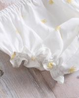 Imagen de Vestido bebé palmeras con volante, lazo y tirantes en cuadros mostaza