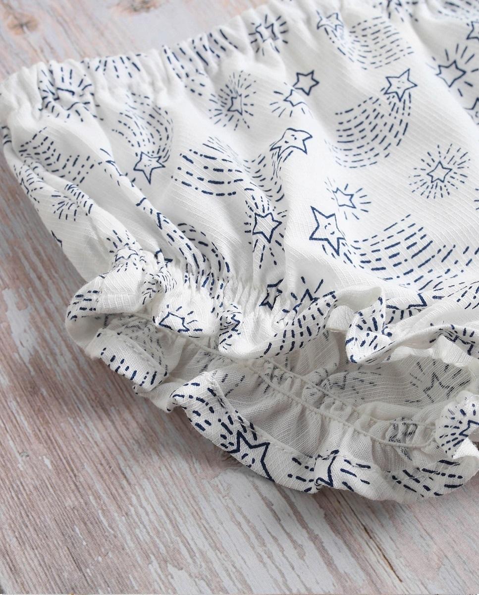 Imagen de Vestido bebé cosmos coral con estrellas en volantes