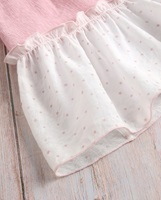 Image de Vestido niña dalia rosa con mangas murciélago de estrellas