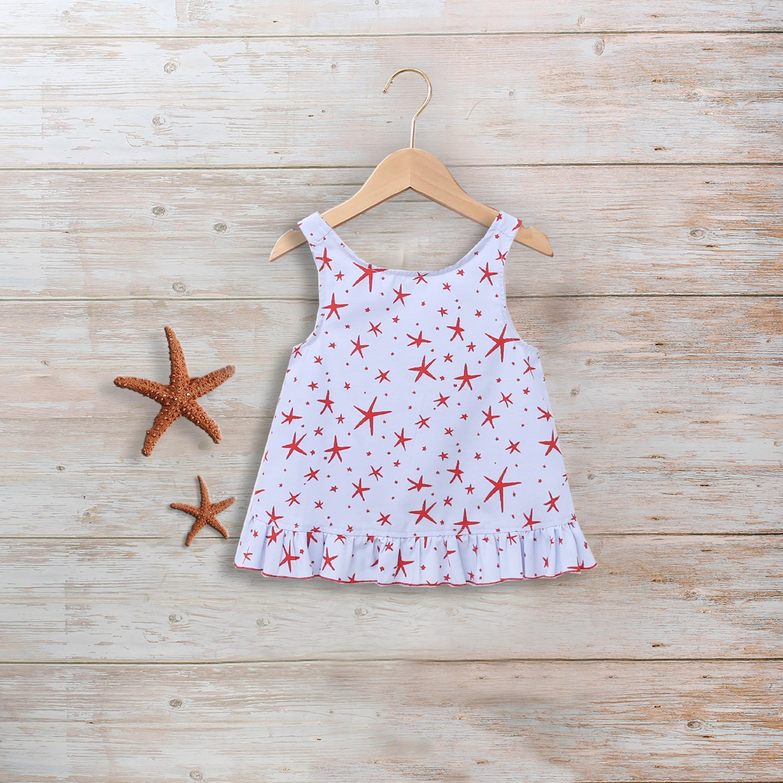 Imagen de Blusa niña azul con estrellas de mar