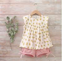 Imagen de Conjunto niña blusa estampados limones y short de rosa bambula
