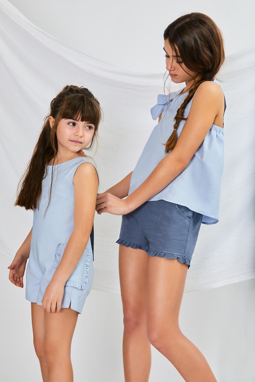 Imagen de Mono niña azul con lazo petroleo en la espalda