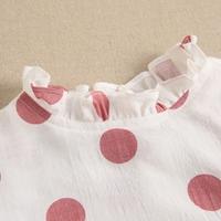 Imagen de Blusa de niña estampado de lunares rosas