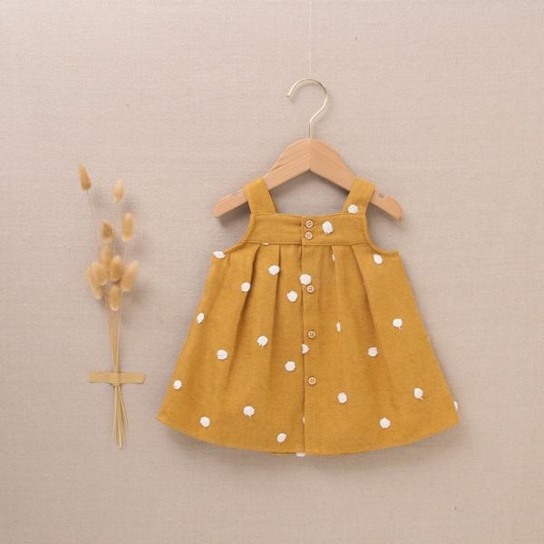 Imagen de Pichi de bebé niña pana mostaza con pompones blancos
