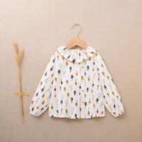 Imagen de Blusa de niña estampado de gotas mostaza gris