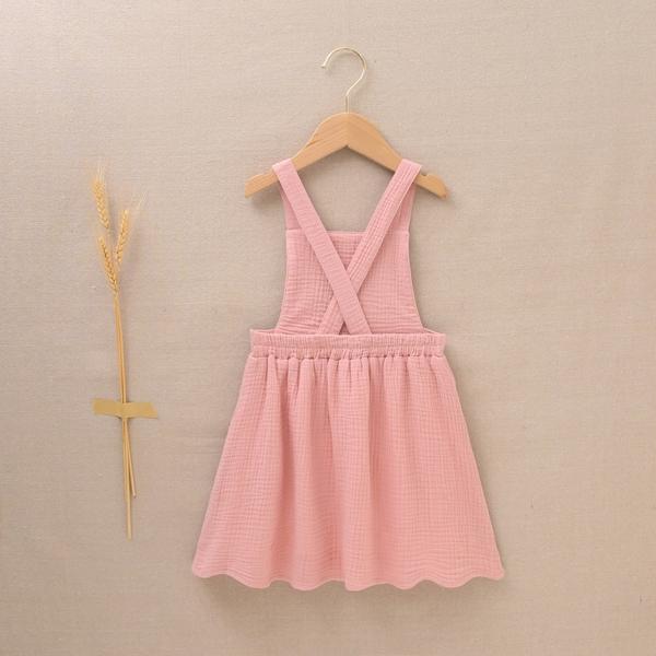 Imagen de Pichi de niña bambula rosa con bordados de ramas