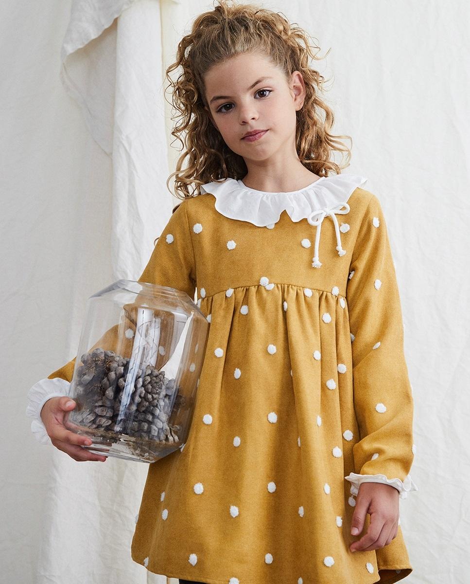 Imagen de Vestido de niña pana mostaza con  pompones blancos
